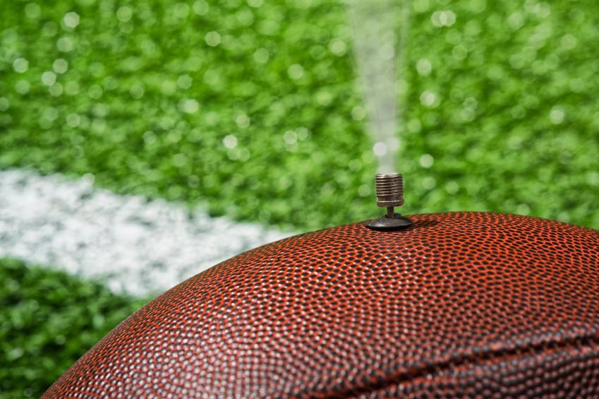 Deflate-Gate. NFL football deflated on the field